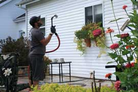 Curb Appeal Pros specializes in low pressure washing to safely clean houses in St. Louis.