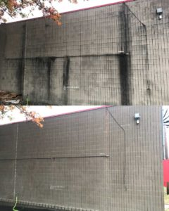 The side of a concrete building before Curb Appeal Pros and after